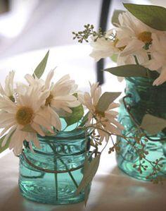Daisy and mason jar centerpieces