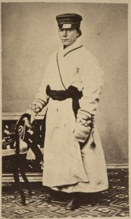 Jääskeläinen man in winter suit wearing nalbound mittens, Finland ?1868?
