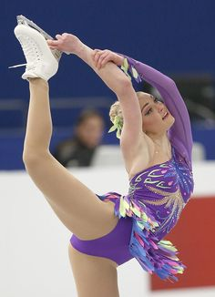 Testing the stretch of her peacock-inspired costume, Joshi Helgesson of Sweden performs during the women's short program at the European Fig...