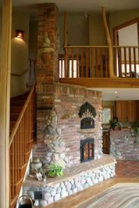 i like the column type chimney at the end of the unit. it would make a good room divider with a counter along the top
