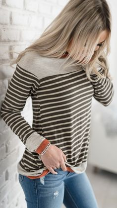 LOVE this striped olive and orange top from Mindy Mae's Market! They have the cuuuuutest clothes! #top #getinmycloset #fashioninspiration {aff}