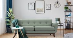 Black table next to sofa with green blanket in cozy apartment interior with gallery of posters Cozy Apartment, Small Apartment Decorating, Apartment Interior, Room Interior, Apartment Living, Apartment Ideas, Home Staging, Green Blanket, Decoration Bedroom