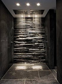 beautiful idea for a bath using texture in the wall like stone look combined with the recessed light in the ceiling modern style .