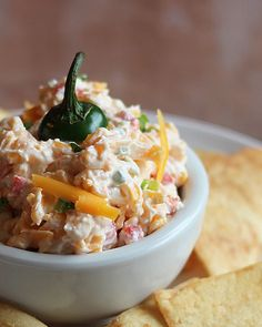 Jalapeno Pimento Cheese~ •4 cups shredded extra-sharp cheddar cheese •8 ounces cream cheese, softened •1/2 cup mayonnaise •1/4 teaspoon garlic powder •1/4 teaspoon onion powder •1 jalapeno pepper, seeded and finely minced •1 (4 ounce) jar diced pimentos, drained • Salt and pepper, to taste