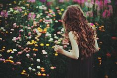 secret garden hidden in the forest, it was very rainy day by laura makabresku, girl in yellow, orange, and pink flower field