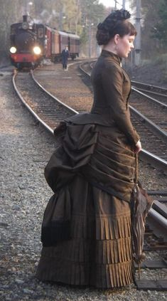 """1878 - 1890 Victorian.""  This looks like a modern-day movie costume (for Anna Karenina maybe? Oogh, that train), and I think the date may be off, because the bustle looks like the earlier style. Again, not mourning, but close."