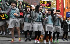 South Korean high school girls cheer for their senior classmates taking the College Scholastic Ability Test on November 8, 2012 in Seoul, South Korea. (Photo by Chung Sung-Jun/Getty Images)