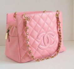 CHANEL handbag; pink tote purse. Quilted with gold detailing makes the baby pink color pop