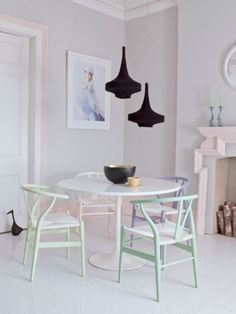 pastel with small black focal point. hans wegner wishbone chairs around a saarinen dining table. i love it!