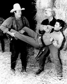 Bonanza Dan Blocker Lorne Greene Michael Landon Playing In Hay 8x10 Photo