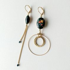 Asymmetrical earring pair made with a vintage black glass navette, vintage glass cabochon with roses decal, vintage ribbed brass hoop and chains, and a gold plated hoop. Securely closes with gold plated over brass lever back ear wires. * NICKEL FREE, like all my earrings. Will