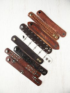 Leather Belt Bracelet  http://www.freepeople.com/whats-new/leather-belt-bracelet/  Leather cuff bracelet made from reclaimed, vintage belts. The vintage belts used to make these cuffs were found at the local antique flea markets in the Bay Area of San Francisco, CA. No two cuff bracelets will be exactly alike.