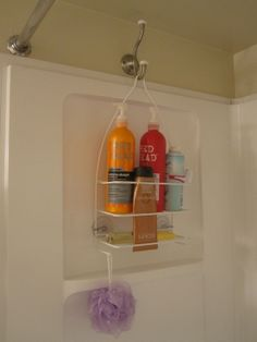 Hang a shower caddy on the opposite side of the shower with a coat hook so it doesnt interfere with the faucet- Duh!!!! And stuff doesnt get all mildewy and gross