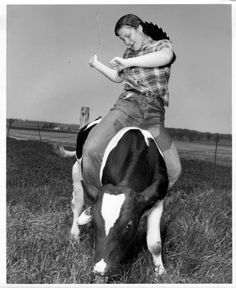 Girl riding a cow, V