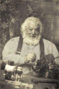 Vintage photo of Santa Claus in his workshop making toys