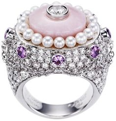 Piaget Limelight Garden Party ring in 18K white gold, set with one pink opal (approx. 7.76 ct), 8 pink brilliant-cut sapphires (approx. 0.92 ct), 18 white pearls and 167 brilliant-cut diamonds (approx. 5.67 ct).