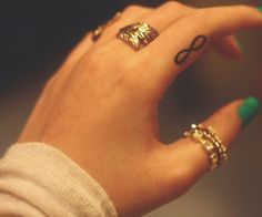 Rings and tat (I have the same tattoo on my back/shoulder-matches my hubby's on his chest)