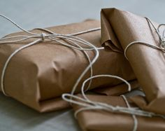 brown paper packages tied up w. string.