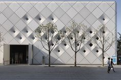UBPA B3-2 Pavilion by Studio Archea  It's clad in diamond-shaped panels of flexible silicon fabric.