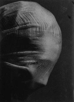Photo by Josef Sudek - Profile of a veiled head, 1942.