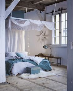 Enchanting white and blue bedroom with canopy bed
