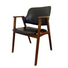 A Mid-Century leather arm chair with stud detailing. This chair was bought at an estate sale and is not marked. The chair is in excellent condition aside from some minor scuff at the base of the legs.