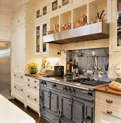 The neutral cabinets here have what I think is the ultimate accent...even though this kitchen is gorgeous, it is the stove that takes the center of attention