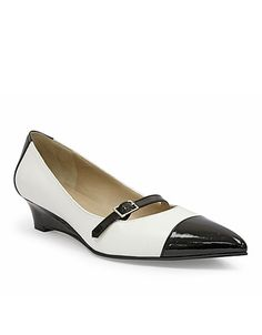 A patent leather pointed toes adds for a contrasting touch to these mary jane wedges! #lordandtaylor