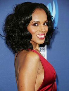 Kerry Washington's curly bob hairstyle with pink eyeshadow and coordinating lipstick | allure.com
