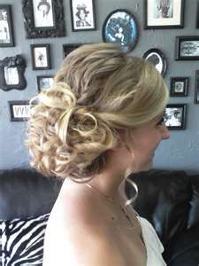 smooth front side swept bands but full curls and volume on top