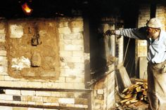 Mick Casson firing his kiln, Wobage Farm, UK  He built his first wood-fired kiln there in 1978 with help from Andrew McCarva.