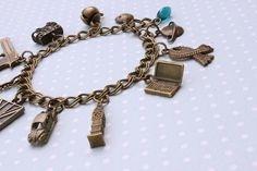 Sherlock charm bracelet - Sherlock Holmes and John Watson, Consulting Detectives, London by otterlydesign, $35.49    The adventures of Hat-man and Robin, the web detectives.    This bracelet will make a lovely accessory for any Sherlock fan, with charms signifying John and Sherlock and their adventures in London.