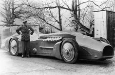 Malcolm Campbell shows off the Bluebird car of 1930, Donald Campbell's father, also a LSR breaker