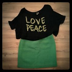 LOVE PEACE Crop Top This crop is off the shoulder.  Black top with green  stud lettering. Joyce Leslie Tops