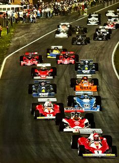 1976 Belgian Grand Prix | Circuit Zolder, Heusden-Zolder, Belgium | The pack is led by Niki Lauda in the #1 Ferrari 312 T2 | In the #11 McLaren M23 was James Hunt followed by Clay Regazzoni in the # 2...
