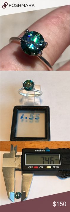 1.55 ctw stunning emerald green WOW This is absolutely the most stunning stone I have ever received. Wow it has so much fire. It's green but I think the color would change to blue depending on what you are wearing... vvs clarity this is a loose stone. It in a setting. Jewelry Rings