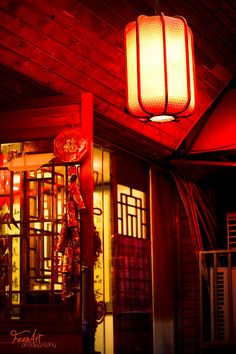 A single traditional chinese lantern can be a good idea for a lighting source/ red and yellow colour palette