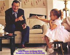 John Wayne enjoying his daughter Aissa, early 60's