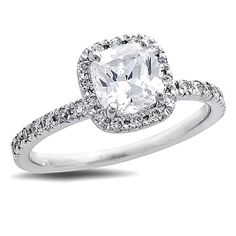 Honor the one you love with this classic diamond engagement ring. Created in sleek and durable platinum this ring showcases a stunning 1 ct. certified cushioncut diamond center stone with a color ranking of H and clarity of SI2. A halo frame of smaller round accent diamonds surrounds the center stone and also lines the rings shank. Designed to sparkle for a lifetime this ring captivates with 114 ct. t.w. of diamonds and a polished shine. The ring arrives with a certificate that includes a…