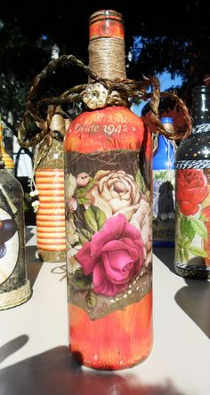 Decorated bottle with decoupage by Carlos Rossi