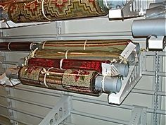 Montel's Heavy Duty Rolled Textile System.  Used for the bigger harder to manage rolls, such as rugs.  Designed and Sold by The Museum Specialists ARTisticStorage.com