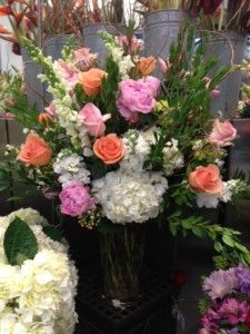 """White, peach and pink wedding bouquet as featured on the 1800Flowers' flower blog, Petal Talk post, """"It's a Nice Day for a White Wedding' with White Wedding Flowers."""""""