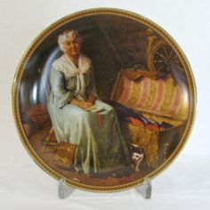 """""""Reminiscing in the Quiet,"""" No. 12 in Rockwell's Rediscovered Women series, this plate originally issued in 1983. Edition limited to a maximum of 100 firing days; this plate bears number 6692J, Bradex No. 84-R70-4.12. Previously owned but ..."""