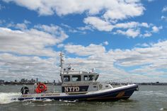 NYPD support boat. [photo: Ed Dutchmazz]