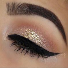 Shimmer + winged eyeliner.