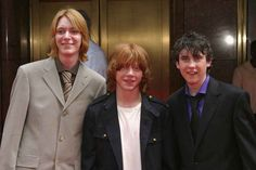 """James, Rupert, and Matthew posed for an awkward shot. 