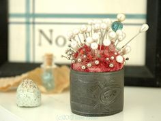 pincushion made from antique silver napkin ring