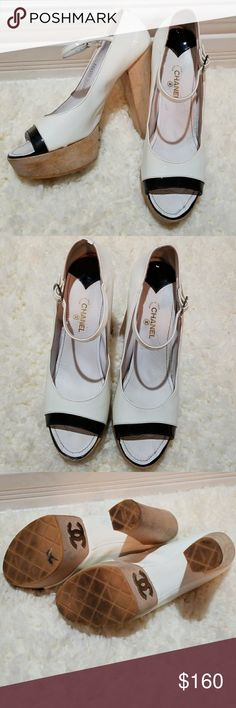CHANEL Wood Platform Heels Stunning white and Black patent leather CHANEL Heels. Statement piece with lots of life left in them. Some wear on foot bed and slight scuffs on wood heels. Could be buffed out. One buckle is missing pin but shoes still wearable. CHANEL Shoes Platforms