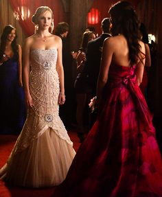 Caroline doesnt look happy with the still turned off Elena
