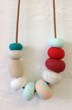 Fimo, which you can buy from most craft shops and online, is a brilliant craft material. Simply sculpt some shapes from the clay (leaving a hole to thread a chain through) and stick it in the oven to create a winning necklace for your mate. [Photo: Pinterest]